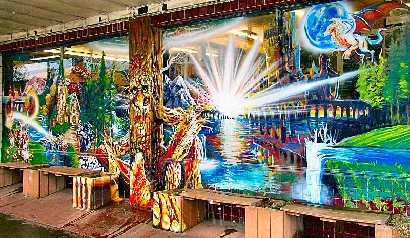 RITA A. LEONARD - This new magical mural has appeared on the Woodstock Boulevard side of Ottos famous Sausage Kitchen.