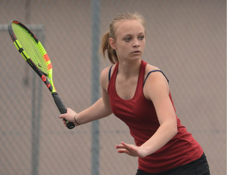 PMG PHOTO: DAVID BALL - Sandys Madison Krening prepares to hit a forehand shot down the line in her straight-set win at No. 2 singles.