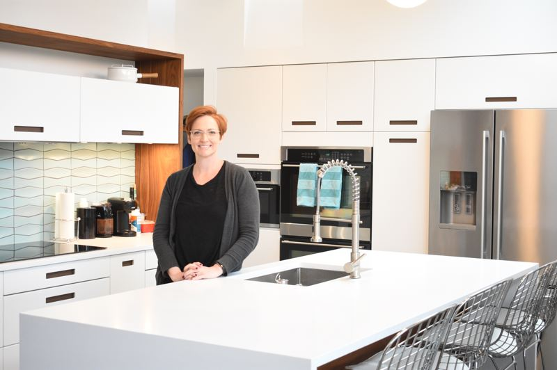 PMG PHOTO: TERESA CARSON - Marisa Swenson shows off the new kitchen in her mid-century modern-style home. It is one of two Gresham homes included as part of a regional tour.
