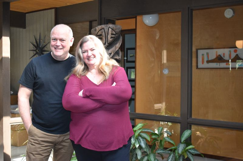 PMG PHOTO: TERESA CARSON - Despite the decade of intense work on their mid-century modern home, Steve and Haley Lewis are still smiling,