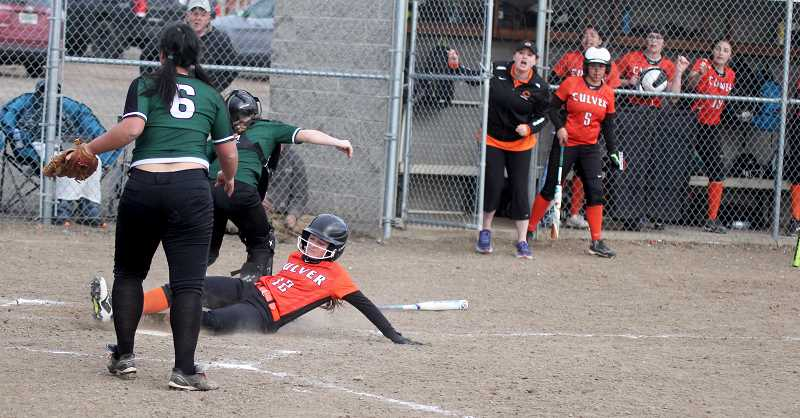 STEELE HAUGEN - Tegan Macy slides into home plate in the bottom of the seventh inning for the game-ending run during Culver's 18-17 win over Delphian April 16.