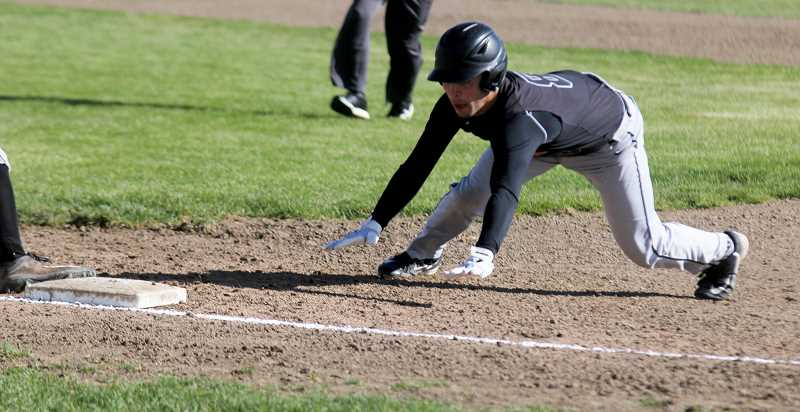 STEELE HAUGEN - Joe Russo slides to head first back to the base. Russo was the only Culver player to get a hit in their first two games against Santiam.