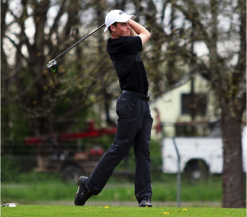PMG PHOTO: DAN BROOD - Sherwood High School junior Mason Bonn watches his drive on hole No. 18 during play at Monday's Pacific Conference tournament.