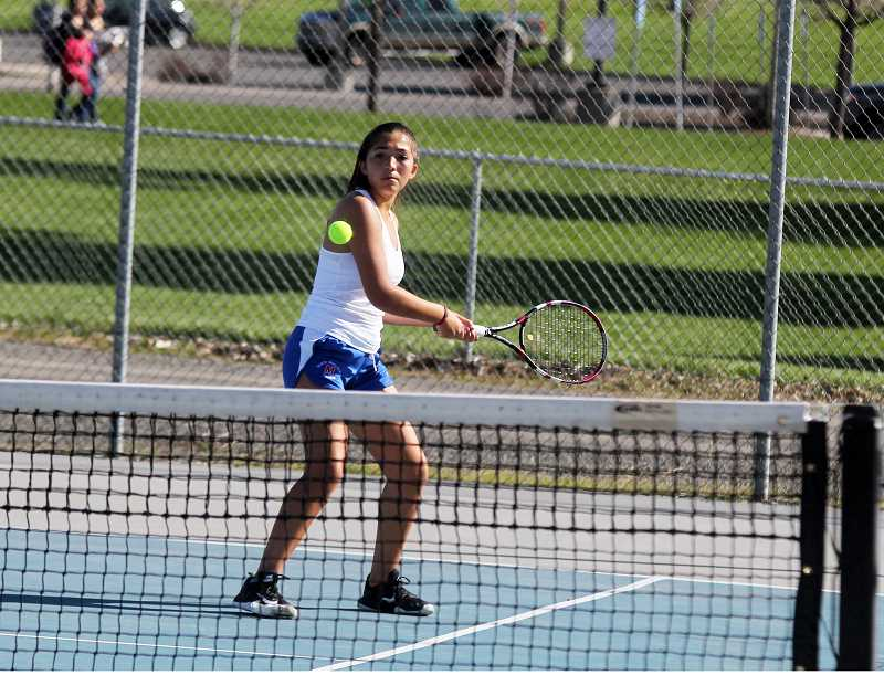 STEELE HAUGEN - Kelsey Olivera returns a server during the No. 1 doubles tennis match against Cascade April 16.