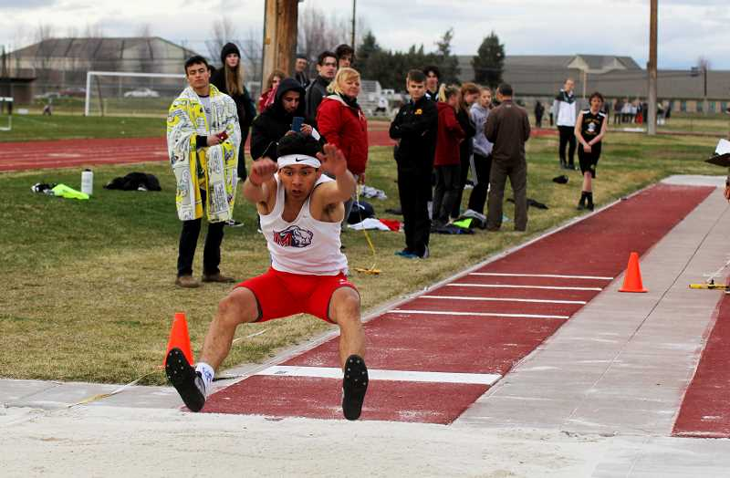 STEELE HAUGEN - Nathan Rodriguez participates in the triple jump. He placed first in the 400-meter run at North Marion April 17.