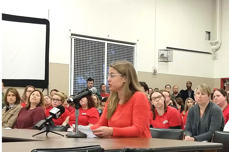 PMG PHOTO: COURTNEY VAUGHN - Sara Schmitt, president of the Beaverton Education Association, addresses budget committee members Monday, April 22 at Merlo Station High School. Teachers turned out in droves to hear a dire message from district officials about proposed budget cuts.