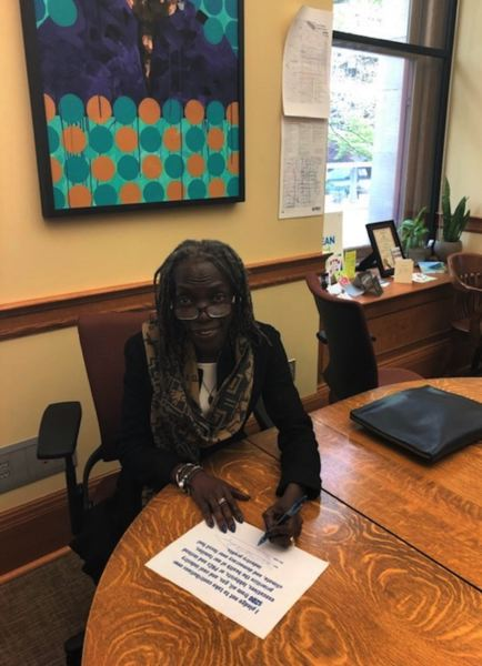 COURTESY PHOTO - Portland City Commissioner Jo Ann Hardesty signs the No Fossil Fuel Money Pledge on Monday, April 22.