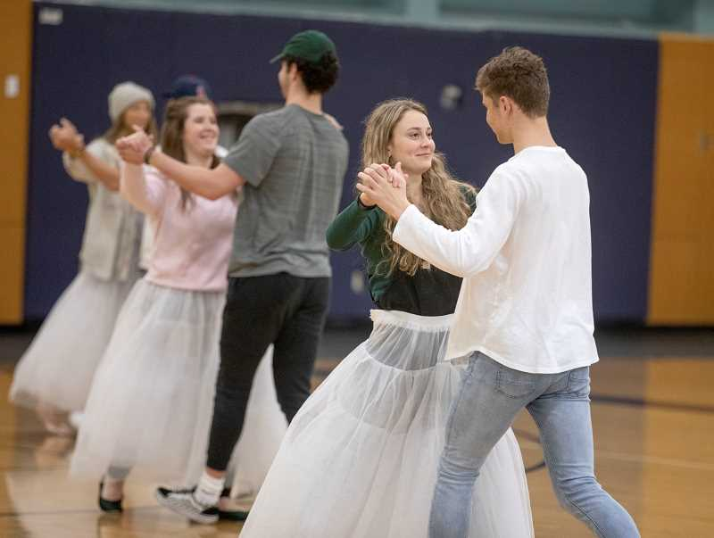 PMG PHOTO: JONATHAN HOUSE - Sadie Crystal and Sam Westing practice a dance routine during Springfest rehearsal.