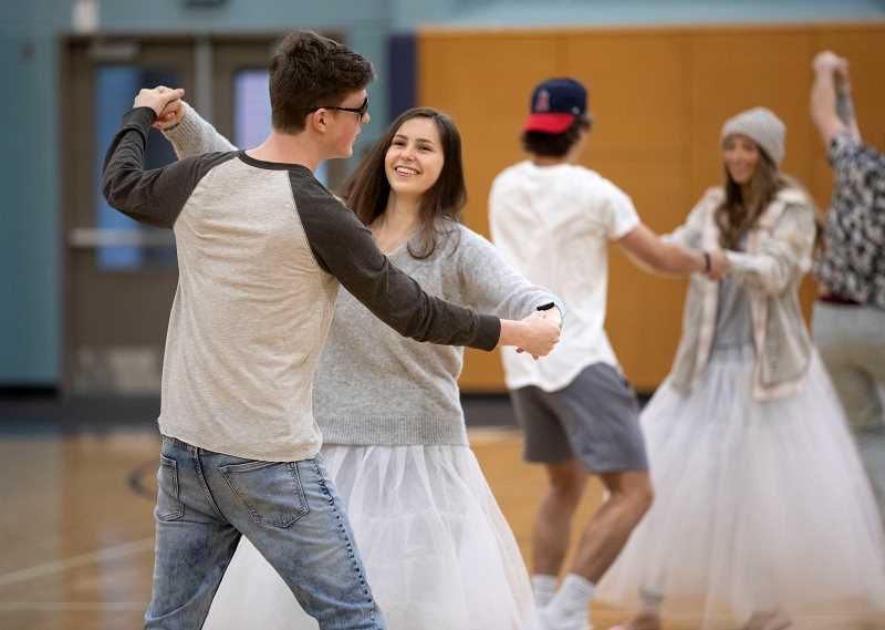 PMG PHOTO: JONATHAN HOUSE - Nathan Tidball and Rachel Cramer practice a dance routine during Springfest rehearsal.