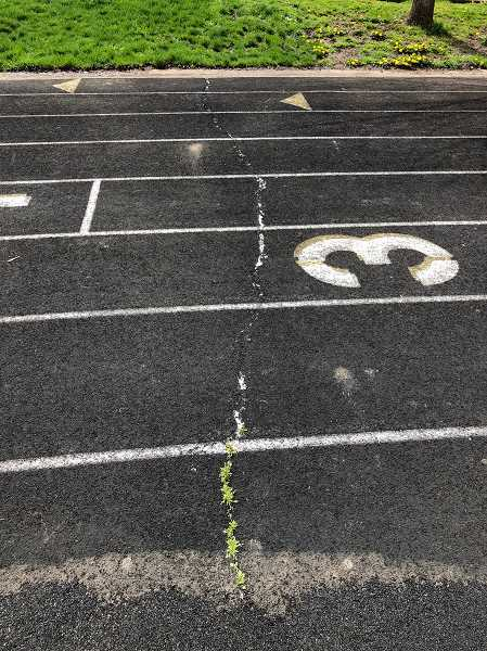 COURTESY PHOTO - The track at Inza R. Wood Middle School, which was last surfaced in 2004, will be replaced this summer.