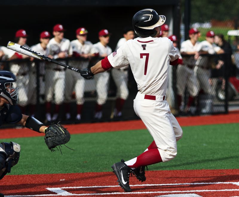 PMG PHOTO: DAN BROOD - Tualatin High School junior Blake Jackson its a pair of doubles for the Wolves in their 8-2 win over Lake Oswego on Tuesday.