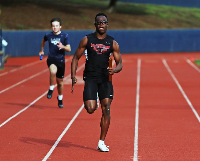 PMG PHOTO: DAN BROOD - Tualatin High School senior Kwabena Lynn, shown here at a meet earlier this season, won the 100-meter dash and was part of the victorious 4 x 100 relay team at Saturday's Wilsonville Invitational.