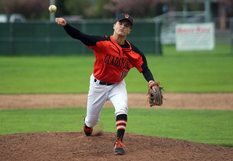 PMG PHOTO: JIM BESEDA - Gladstone's Austin Conner scattered six hits, hit four batters, walked two, and struck out six in leading the Gladiators to a 3-2 Tri-Valley Conerence win Tuesday ever top-ranked North Marion.