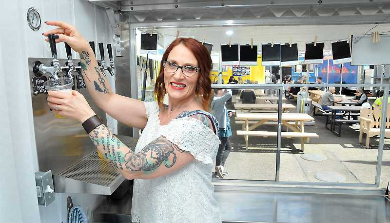 GRAPHIC PHOTO: GARY ALLEN  - Debi Botz can pour beer, wine and hard cider for thirsty customers at the Newberg food cart pod on First Street.