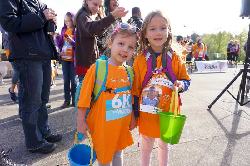 PMG FILE PHOTO: CLAIRE HOLLEY - Ainsley Fisher and her big sister Adelyn, a kindergartner at Oak Creek Elementary School, participated in the 2018 fundraiser.