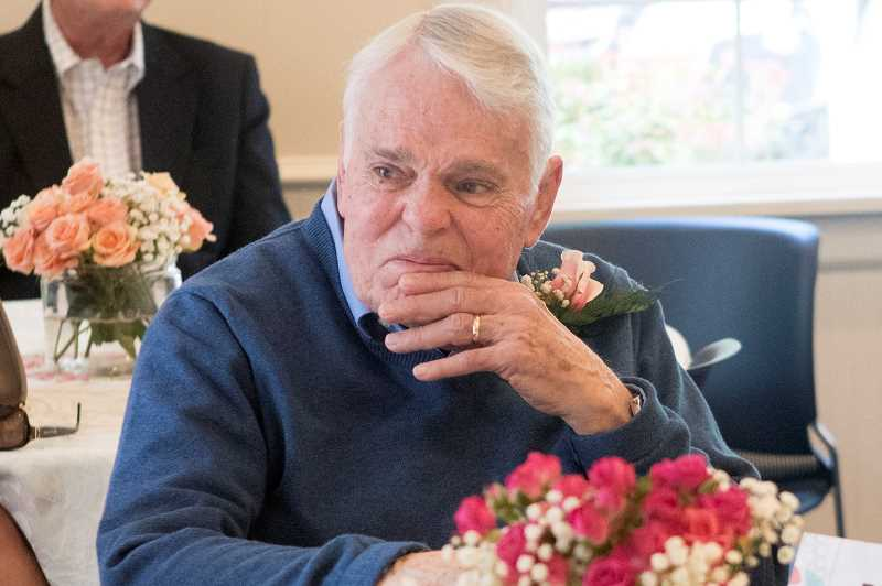 Allen Powers holds back his emotions as members of the Lake Grove Garden Club recognize his wife, Ann Powers, who was a longtime member of the club, during a recent luncheon at the Oswego Heritage House.