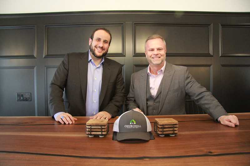 REVIEW PHOTO: SAM STITES - Hanna and Olson pose in their sleek new downtown Lake Oswego office on A Avenue.