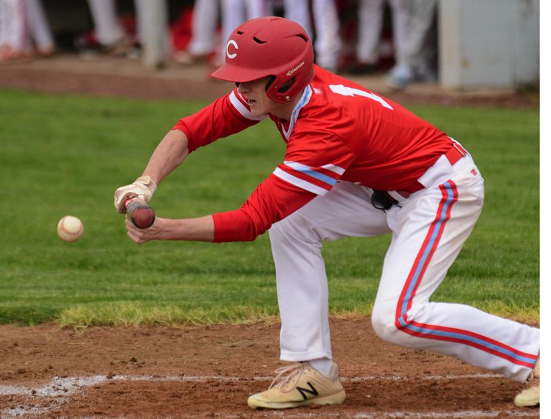 PMG PHOTO: DAVID BALL - Centennials Davis Landolt squares to put a sacrifice bunt in play during the Eagles 10-7 win at David Douglas on Tuesday.