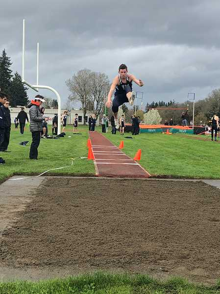 PMG FILE PHOTO: STEVE BRANDON - Freshman Kellen Hartford took first place in the high jump and second place in the long jump.