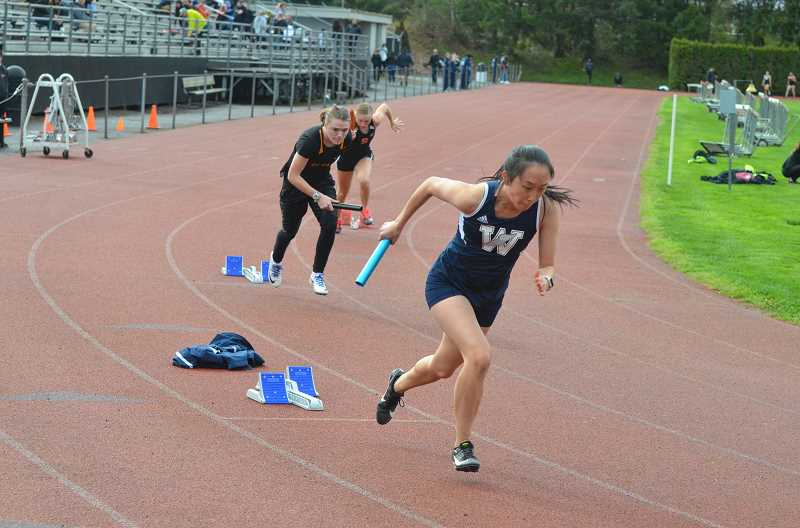 PMG FILE PHOTO: STEVE BRANDON - Senior Kellie Yoshida was a part of the first place 4x100-meter relay team.