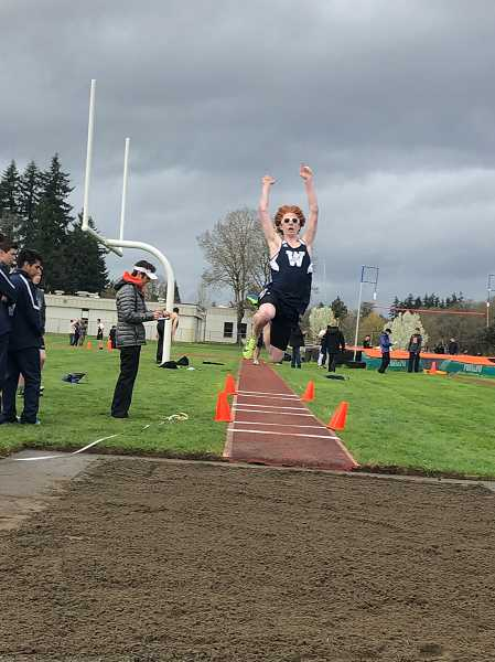 PMG FILE PHOTO: STEVE BRANDON - Freshman Rocco Marshall took first place in the long jump against Milwaukie.