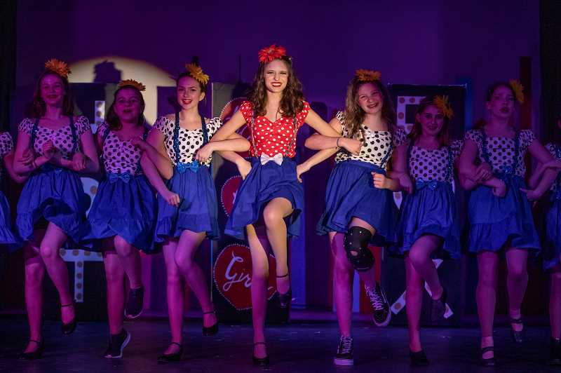 PMG PHOTO: JONATHAN HOUSE - Alli Jaffe, center, plays Adelaide in the Lakeridge Junior High production of Guys and Dolls.