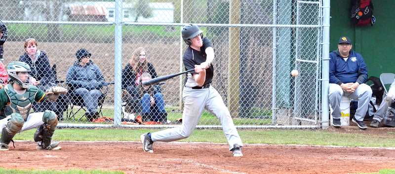 PMG PHOTO: TANNER RUSS - The Cougars' Hadden Stark swings at a pitch against Colton.