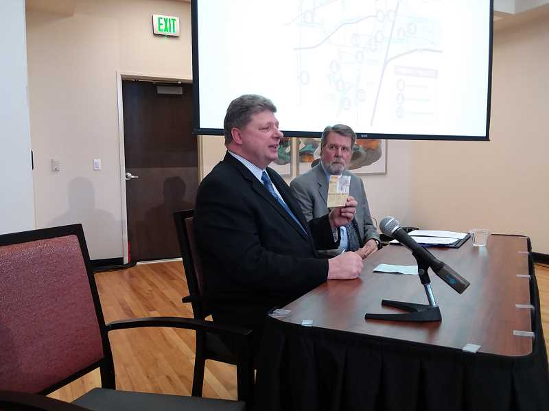 TIMES PHOTO: RAY PITZ - Mayor Frank Bubenik holds up a citizen comment card regarding traffic as Eric Schmidt looks on during Wednesdays state-of-the-city address.