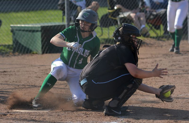PMG PHOTO: DAVID BALL - Reynolds Hailey Burmeister slides home behind Centennial catcher Hadley Cook to put the Raiders up 7-3 in the fourth inning Wednesday.