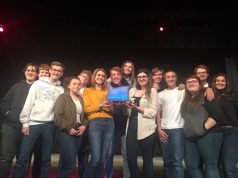 COURTESY PHOTO - Seniors in the St. Helens High School wind ensemble hold their first-place trophy, which they earned at the Northwest Oregon Conference All League competition earlier this month. This the second year in a row the band has earned a first-place title at the competition.