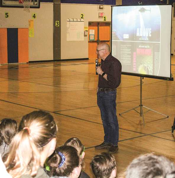 HOLLY SCHOLZ - Oregon author Roland Smith tells Crook County Middle School sixth-graders his book-writing process.