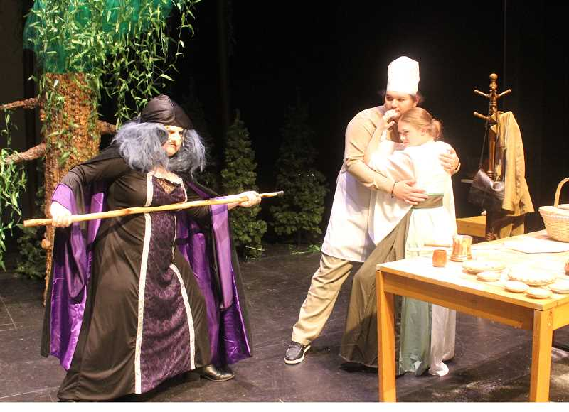 DESIREE BERGSTROM/MADRAS PIONEER - The Witch (April Cunningham) puts the fright into the Baker (Nacho Ruiz) and his wife (Emily Plant).