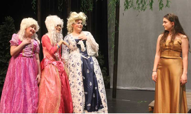 DESIREE BERGSTROM/MADRAS PIONEER - Cinderella (Allison Turek) at right, is abused by, from left, her stepsisters (Gillian Ahern and Vanessa Young) and stepmother (Aurora Strode).