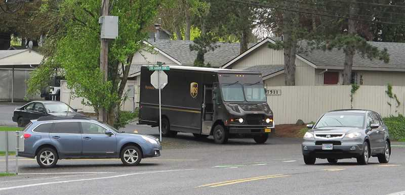 One of the problems with the intersection has been the difficulty of turning left from Southwest 69th Ave. (note the UPS truck) or mergining from Garden Home Road with Multnomah Boulevard westbound (note the SUV.)