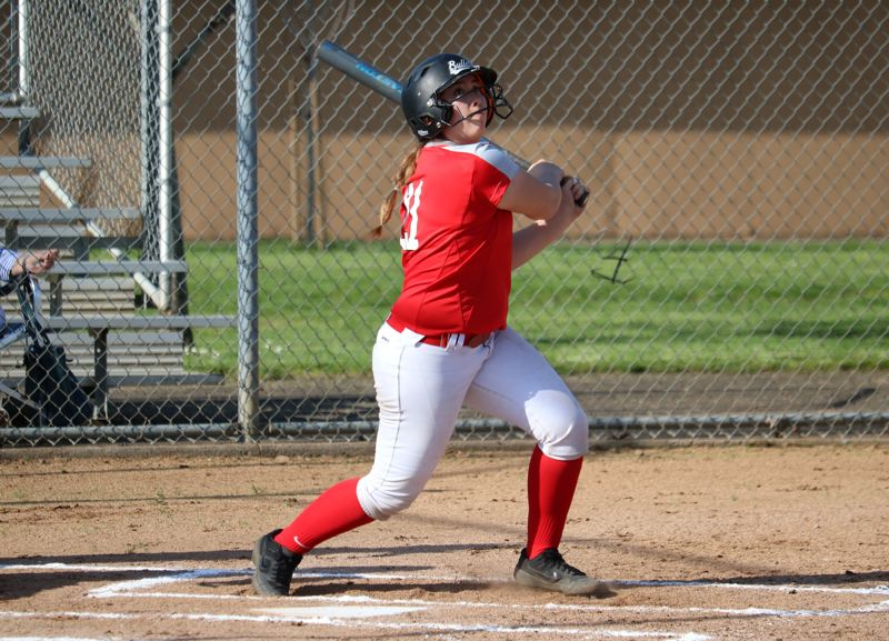 PMG PHOTO: JIM BESEDA - Oregon City's Isabelle Lewis went 2 for 4 with an RBI-double in the sixth inning that scored Phoebe Borkus and gave the Pioneers a 6-5 lead Wednesday against Lake Oswego.