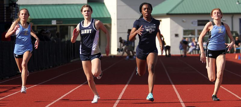 PMG PHOTO: MILES VANCE - Lake Oswego junior Gemma Pleas (second from right) speeds to victory in the girls 100-meter dash during her team's meet at Canby on Wednesday, April 24.