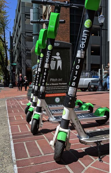 PMG: JOSEPH GALLIVAN - Lime scooters were the firston the streets of Portland Friday, having been awarded a license by PBOT. They are joined by Bolt and Spin, both of which are new to Portland.