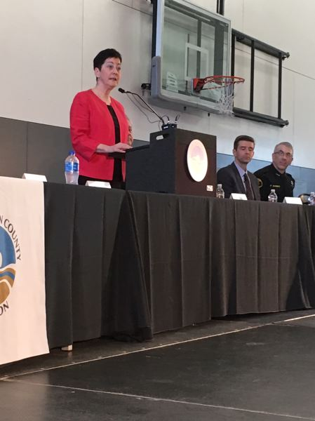 PMG PHOTO BY PETER WONG - Board Chairwoman Kathryn Harrington speaks while District Attorney Kevin Barton and Sheriff Pat Garrett await their turn during a state of Washington County presentation April 17 in Beaverton.