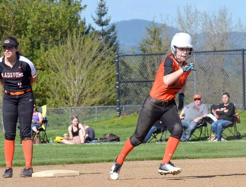 PMG PHOTO: TANNER RUSS - Molalla's Rachel DeRosa rounds second base after teammate Amanda Wendell cracked a double into left field.