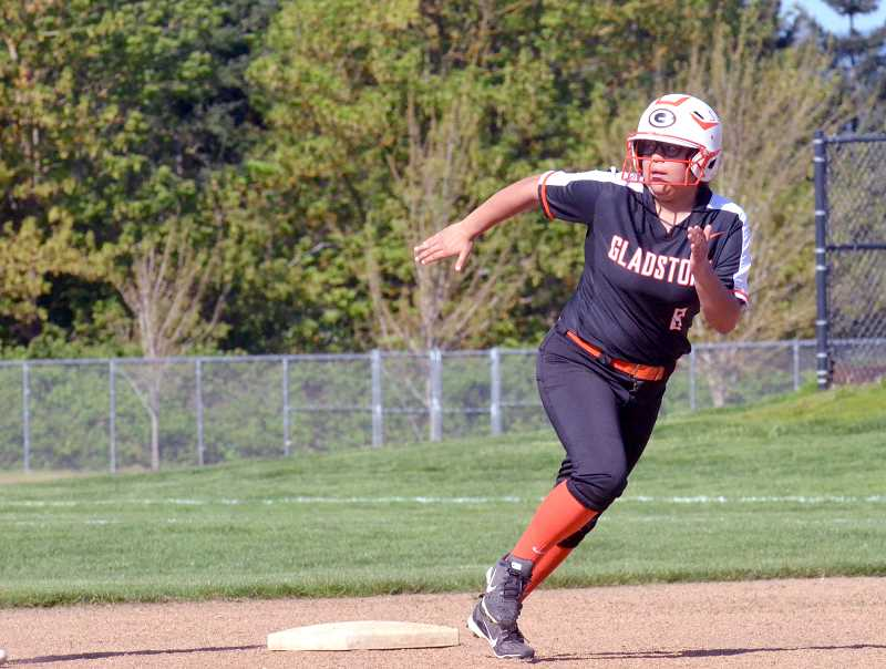 PMG PHOTO: TANNER RUSS - Gladstone's Jasmin Torres Zaines rounds second base at Molalla softball field.