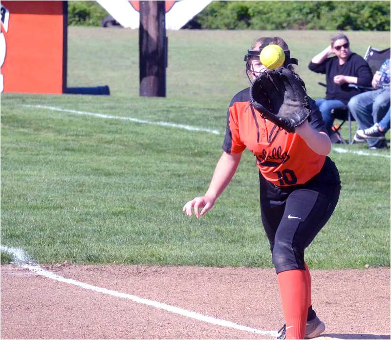PMG PHOTO: TANNER RUSS - Molalla's Jessica Hewitt makes the catch at first.