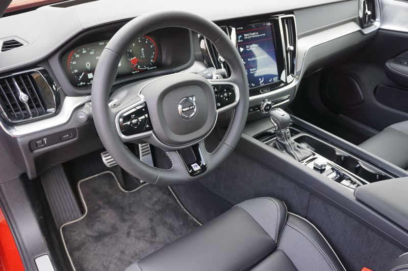 PMG PHOTO: JEFF ZURSCHMEIDE - The interior of the 2019 Volvo S60 R-Design AWD is thoroughly modern and totally luxurious, and drivers will enjoy the thick leather-wrapped steering wheel and custom trim.