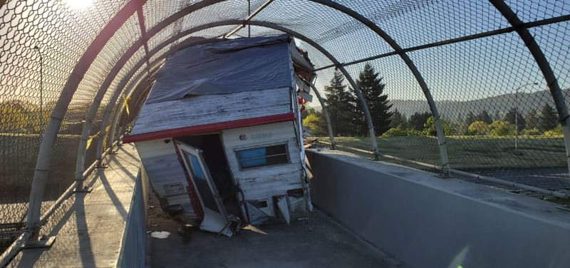 PPB PHOTO - A camper living attachment was left abandoned on an Interstate 205 overpass reserved for walkers and cyclists in Portland overnight on Sunday, April 28.