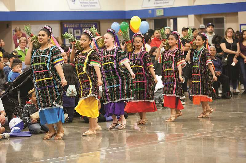 PMG PHOTO: JAIME VALDEZ - Ladies performs Flor de Piña (Pineapple Flower) Dance during the Dia de Nino event at Woodburn High School.