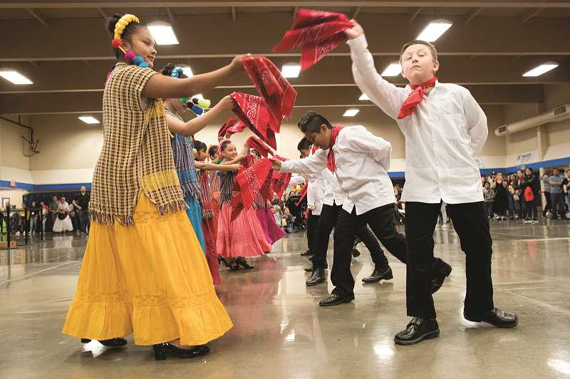 PMG PHOTO: JAIME VALDEZ - Youth from Coscha Mestiza dance during the Dia de Nino event at Woodburn High School.