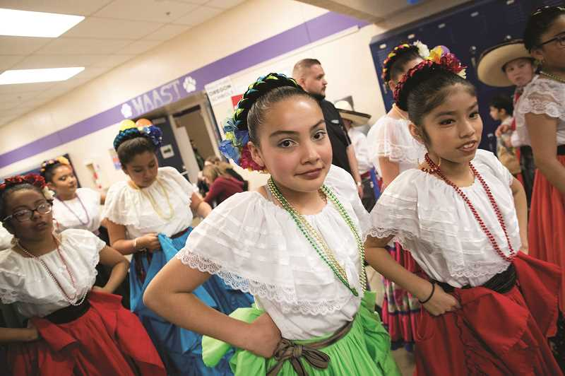 PMG PHOTO: JAIME VALDEZ - Youth from Coscha Mestiza prepare to dance during the Dia de Nino event at Woodburn High School.