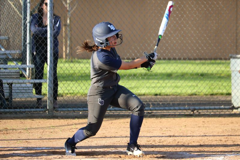PMG PHOTO: JIM BESEDA - Lake Oswego's Vivian Rittenour came through with the game-tying hit in the bottom of the seventh inning and the Lakers pulled away to beat Oregon City 11-6 in the eighth on Wednesday, April 24, at Oregon City High School.