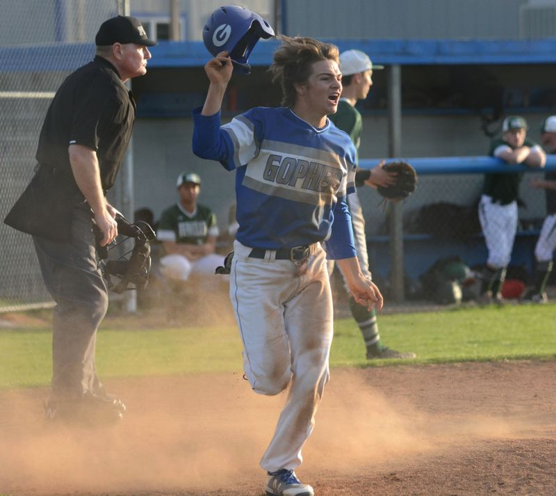 PMG PHOTO: DAVID BALL - Greshams Reece McKenzie lets out a shout after sliding home with the winning run in the bottom of the seventh inning.
