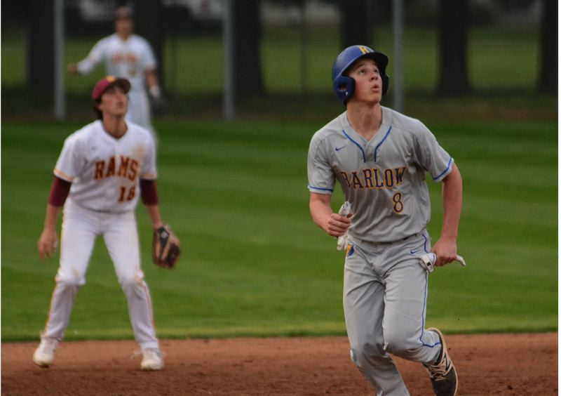 PMG PHOTO: DAVID BALL - Barlows Titus Dumitru watches a fly ball head to left field while moving around the bases during the Bruins 1-0 loss to Central Catholic last Thursday.