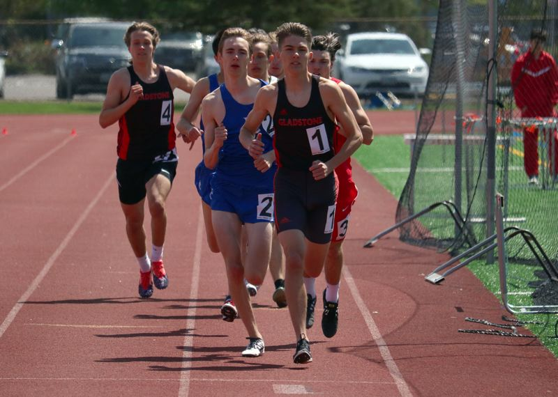 PMG PHOTO: JIM BESEDA - Gladstone's Konnor Hathaway moved to the front of the pack off the start of the boys 800-meter run and pulled to win in 1 minute, 58.3 seconds at Saturday's 14th annual Dick Baker Invitational.